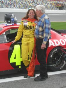 Jill George poses by her 48 car in pit lane at Daytona International Speedway.