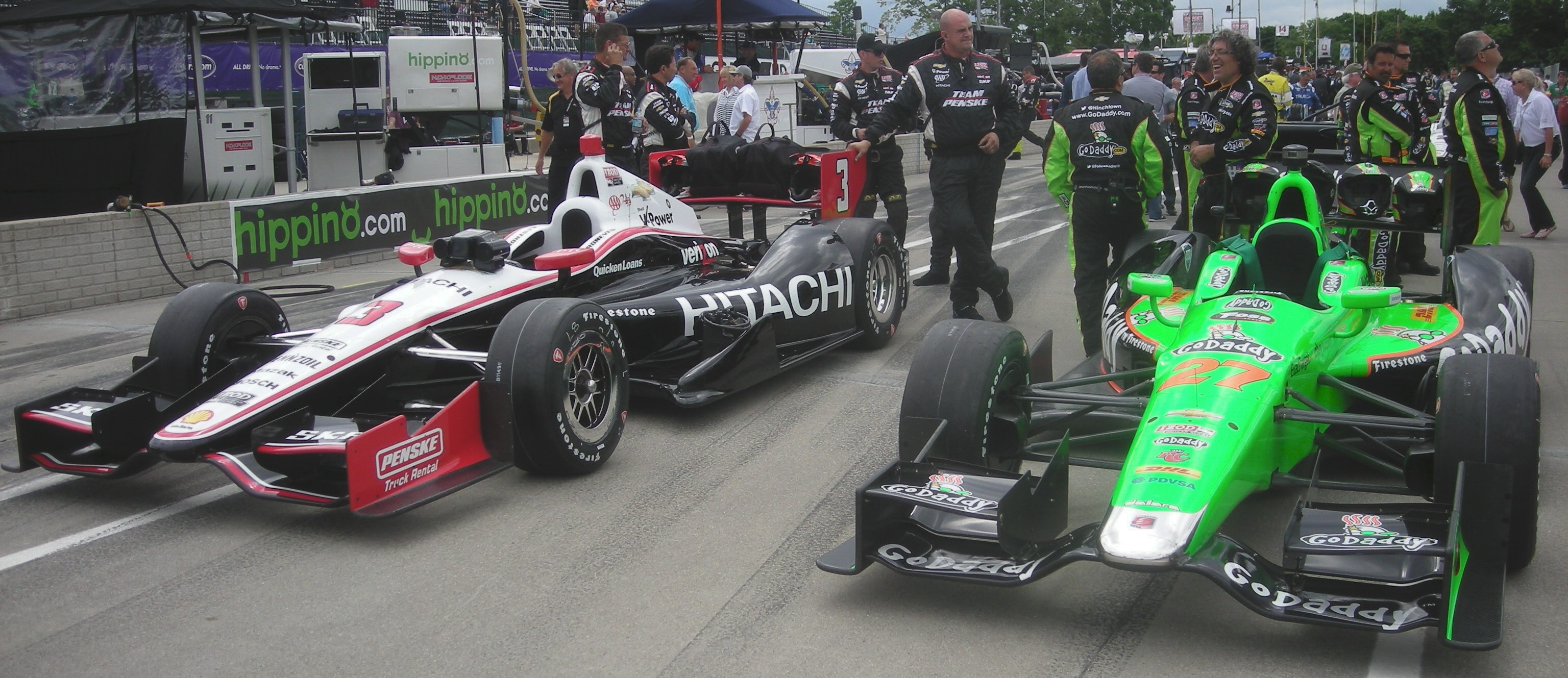 Helio Castroveves' #3 and James Hinchcliffe's #27. Same cars, different colors.