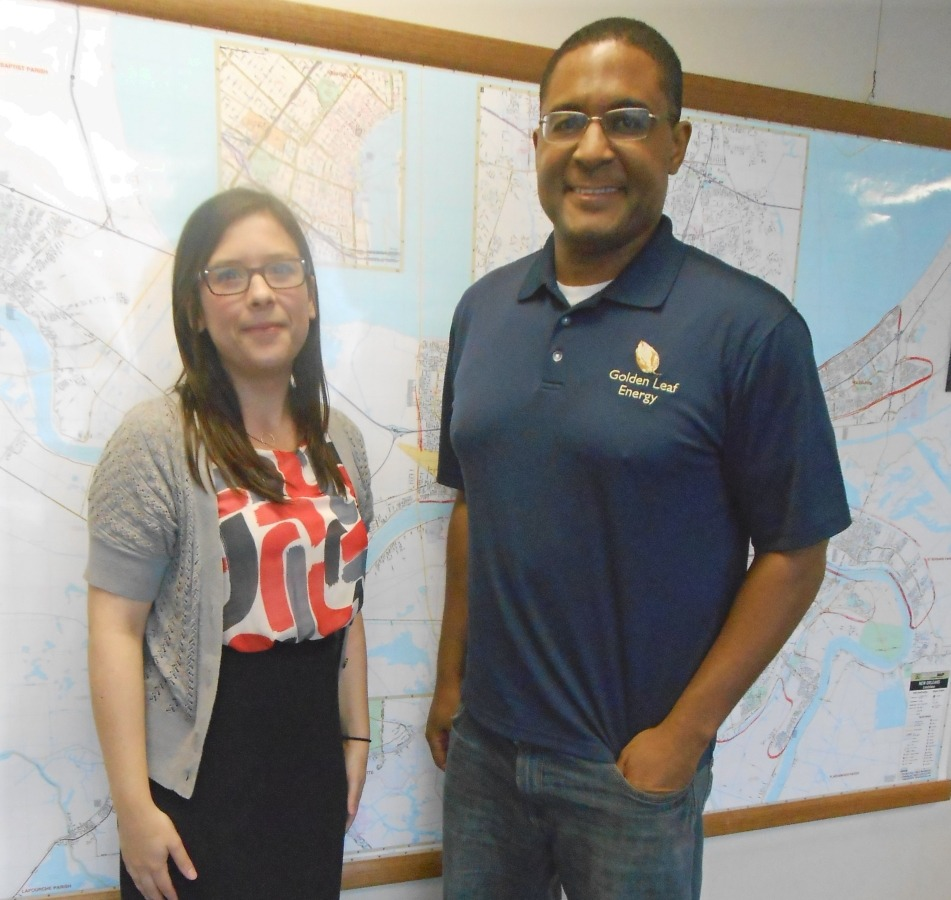 Kate Moreano, Economic Development Specialist from the Jefferson Parish Economic Development Commission meets with Golden Leaf Energy's Troy A. Clark in Harvey, Louisiana.