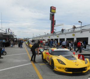 Corvette, now using E20, parades to the track at the Roar before the Rolex 24