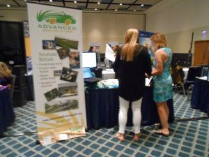 Visitors to Advanced Biofuels USA information table at Energypath 2016