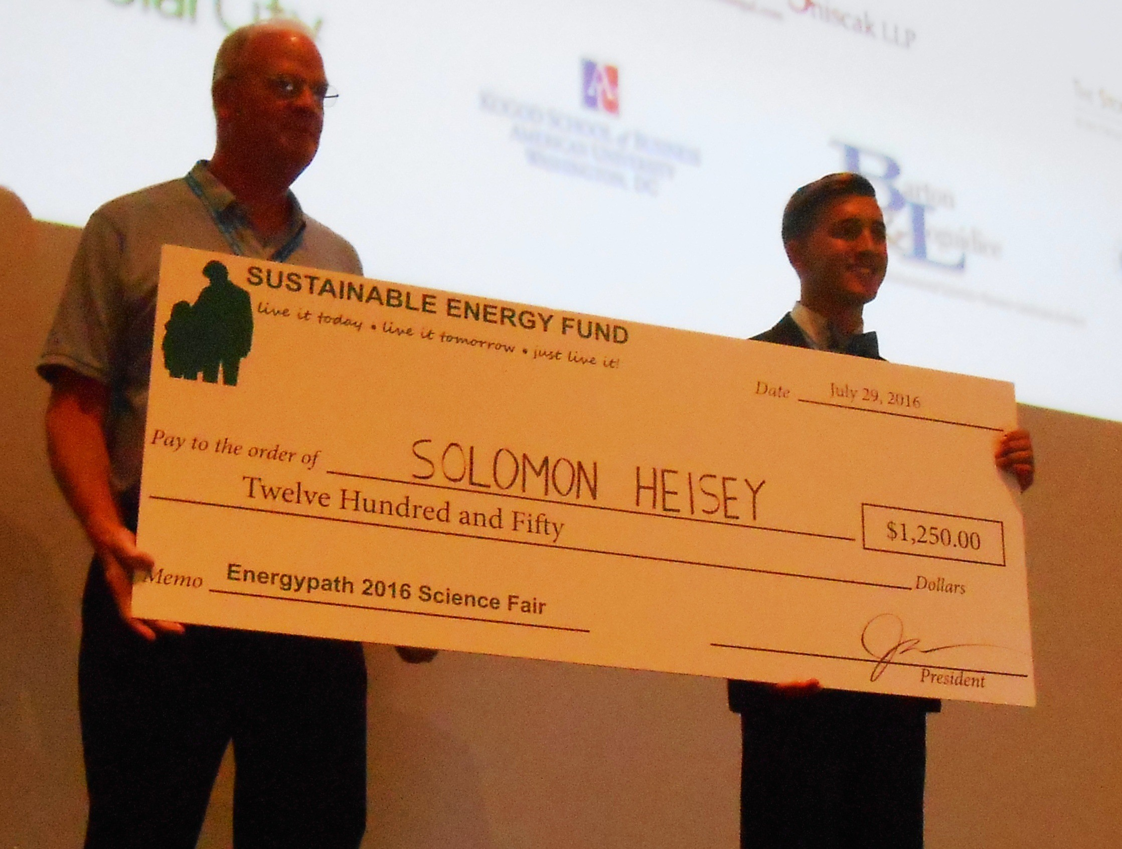"Solomon Heisey takes first prize in the high school competition for ""The Power of Algae"""
